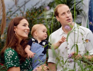 Kate and William spend time with baby George at the History Museum in London this past summer. Photo Credit: New York Times