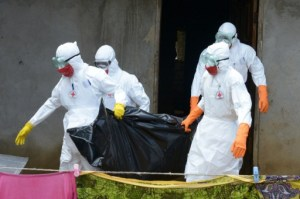 A burial team from the Liberian Ministry of Health loads the bodies of Ebola victims into a truck on Thursday, September 4th in Banjol, Liberia  Photo Credit: CNN