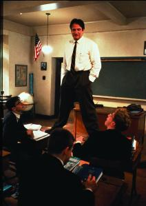 Robin Williams plays his role as John Keating in Dead Poets Society (1989). Photo Credit: Internet Movie Database