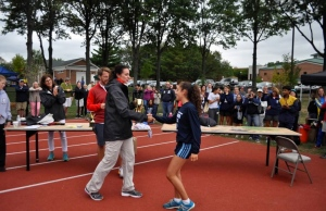 Sophomore runner Giavanna Tabbachino receives her 1st place varsity trophy after racing in the NAI meet.