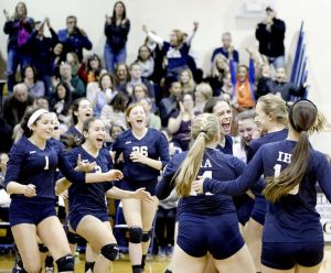 IHA girls rush onto the court to rejoice in their victory. Photo Credit: The Bergen Record