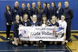 The 2014 IHA volleyball team earns the title of County Champions after defeating Demarest on November 2nd.  Photo Credit: The Bergen Record