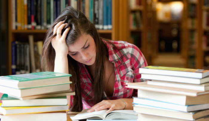 High school students struggle with hours of homework, resulting in fewer hours of sleep.  Photo Credit: Hercampus.com