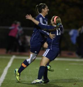 Alex Mesropyan celebrates her game-winning goal with teammate, Katey Samaro. Photo Credit: The Bergen Record