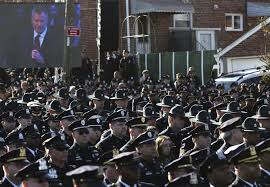 Crowds of police officers turn their backs on Mayor Bill de Blasio at Officer Ramos' funeral. Source: nypost.com