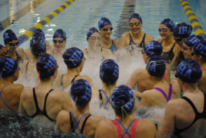 The IHA Swim team huddles together for its team chant at the start of the state championship meet. IHA won the title over Bishop Eustace at TCNJ on Sunday, February 22nd with a final score of 108-62.