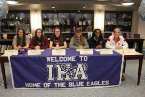 Six IHA seniors excitingly sign to their future schools.