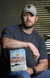 Former Navy SEAL Chris Kyle (pictured above with his autobiography) is shot and murdered by Eddie Ray Routh on Feb. 2, 2013.  Photo Credit: NY Daily News