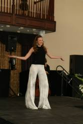 Freshman Julia Morris shows her fun personality as she steps onto the runway. Photo Credit: Mrs. Proscia/Photography Club
