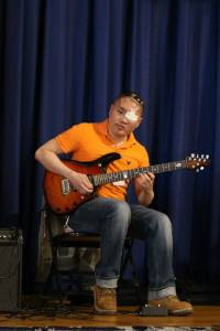 Hurley plays some of his favorite tunes on the guitar for IHA students to enjoy.  Photo Credit: Mrs. Proscia