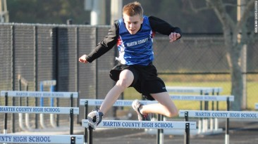 Autistic teen running champion, John Miller, jumps hurdles during track competition in Stuart, Florida.  Photo Credit: CNN