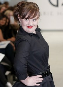 Actress with Down Syndrome, Jamie Brewer, strikes a pose at Carrie Hammer's runway show during the Mercedes- Benz New York Fashion Week.  Photo Credit: KTLA News, Los Angeles