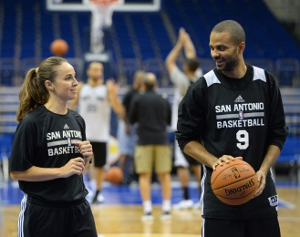 Hammon coaches San Antonio's point guard Tony Parker as part of the 2014 Global Games on October 7, 2014 at the O2 Arena in Berlin, Germany.  Photo Credit: WNBA