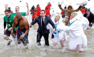 TV host, Jimmy Fallon, plunges into the Atlantic Ocean at last year's Polar Bear Plunge in Chicago, Illinois. Photo Credit: Boston.com