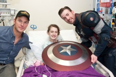 Chris Pratt and Chris Evans visit a patient at Seattle Children's Hospital. Photo Credit: ftw.usatoday.com