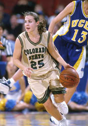 Hammon dribbles the ball down the court in one of her college games against UCLA. Photo Credit: Colorado State University