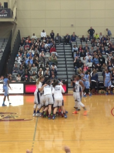 The IHA varsity basketball team rejoice as they claim their second Bergen County Championship in a row/