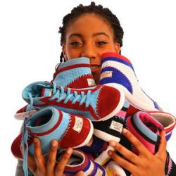Mo'ne Davis holds her new sneaker line. 15% of the proceeds are going to girls living in poverty.  Photo Credit: Black Enterprise