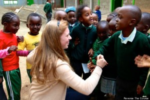 Henry bonds with some young students during her visit to Africa. Photo Credit: Huffington Post