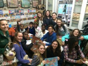 IHA students spend some time at Lazaro Salsita's house with some of the children in the community. Salsita runs a community project encouraging people to produce art.