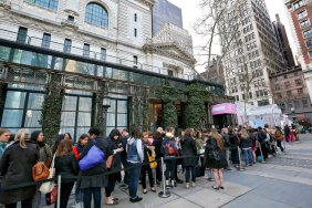 People lined up by the Target in Bryant Park in New York waiting to get to the front of the line to get into the store. Photo Credit: New York Times