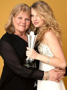 Taylor Swift smiles with her mother after winning at the 43rd annual Academy of Country Music Awards. Swift's mother has been diagnosed for with cancer, but the family is not disclosing any other information at this time. Photo Credit: People Magazine