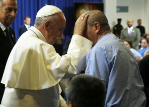 Pope Francis blesses an inmate at the Curran-Fromhold Correctional Facility. Photo Credit: PBS