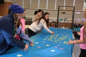 The freshman class decorate the banner for spirit day. Photo Credit: Patrizia Proscia
