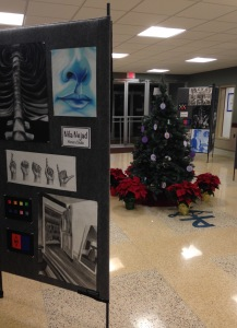 Nila Nejad '16, an Honors Studio student, is on display by the Christmas tree in IHA's lobby. Photo Credit: