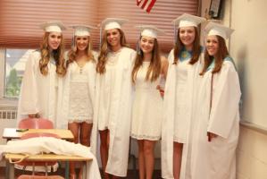 IHA graduates return to their old classrooms to capture the moment. Photo courtesy of Patrizia Proscia