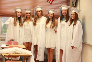 IHA graduates return to their old classrooms to capture the moment. Photo courtesy of Patrizia Proscia