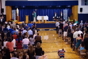 IHA students and their families celebrate mass together. Photo courtesy of Olivia Cantarella'18