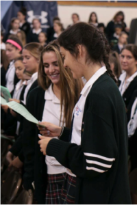 Seniors Olivia Dematteo'17 and Kayla Itez'17 participate in IHA's opening liturgy on September 16th. Photo courtesy of Immaculate Heart Academy