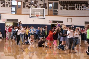 Seniors storm the gym for their last IHA Halloween pep rally. Photo courtesy of Immaculate Heart Academy