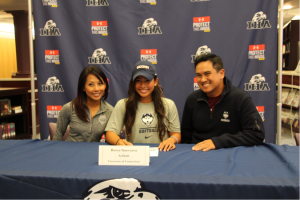 A family affair- Reese Guevarra's family wears their UConn gear as Reese commits to the school. Photo courtesy of Lisa Ferioli'18