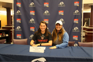 Coach Sue Montegarri proudly smiles as her lacrosse player Regan Bossolina signs to Fairfield University. Photo courtesy of Lisa Ferioli'18