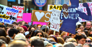 Signs from a Feminist march and protest. Photo courtesy of Church Militant