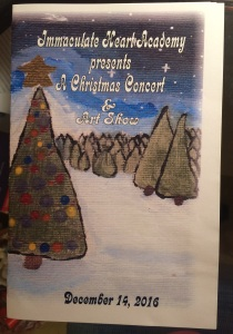 The program for the Christmas Concert and Art Show was designed by Tara Daly'19. Photo courtesy of Bernadette Goratowski'19