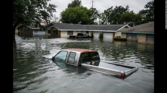 Flood waters destroy many homes and posessions. Photo courtesy of CNN