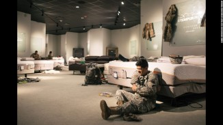 Rescue workers take a rest at a furniture store. Photo courtesy of CNN