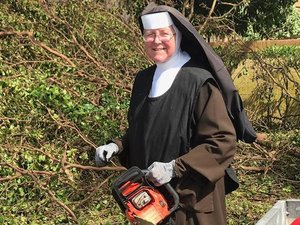 Sister Margaret Ann is practicing what she preaches, and is doing what she can to help. Photo courtesy of Miami-Dade Police Department