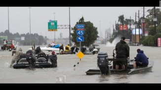 Volunteer boats ride through the waters looking for those in need of rescuing. Photo courtesy of CNN